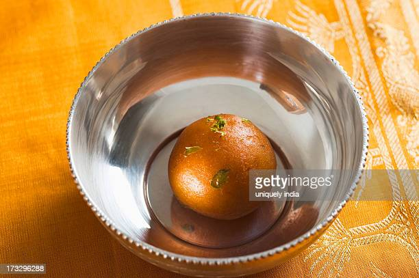 Close-up of a gulab jamun (a popular traditional Indian sweet) in a bowl