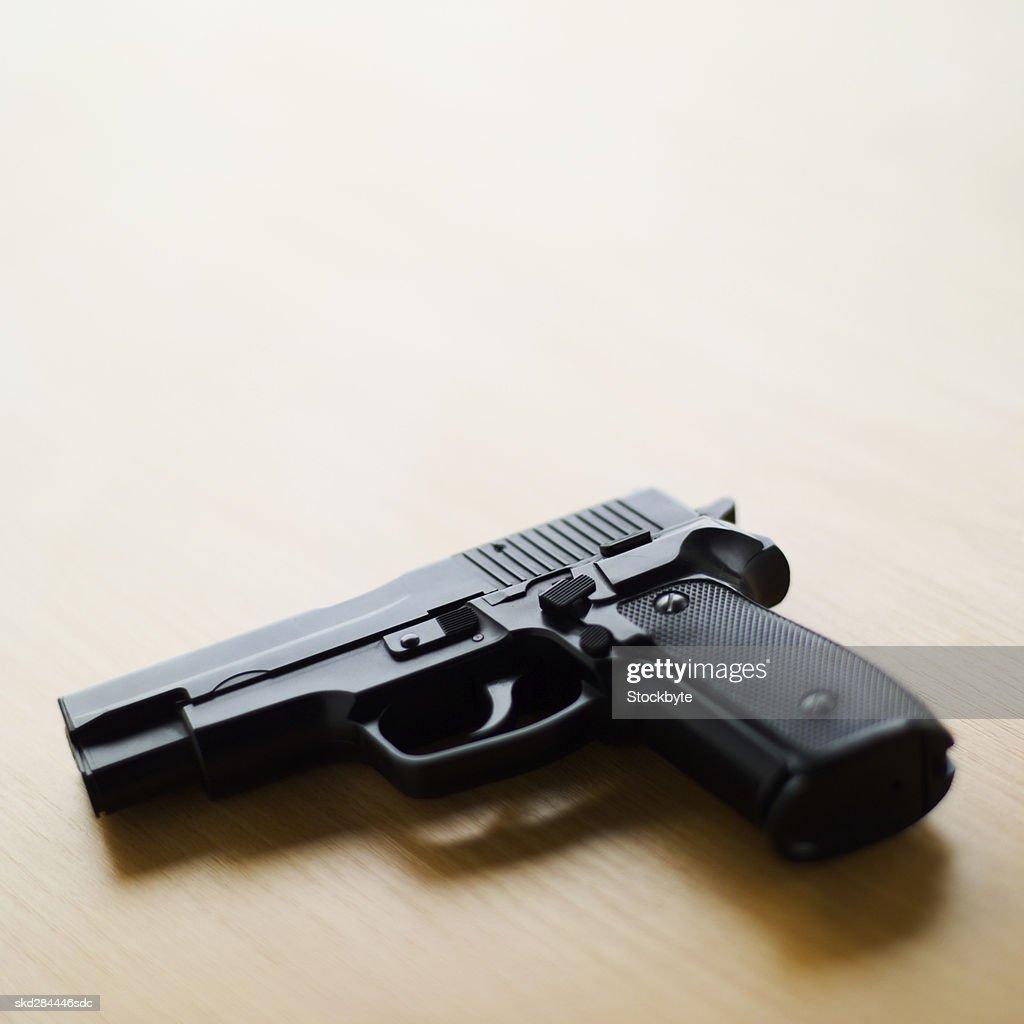 Close-up of a gun : Stock Photo