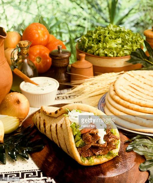 Close-up of a gyro with pita and other ingredients