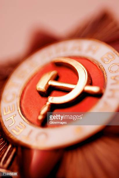 Close-up of a hammer and sickle painted on a badge