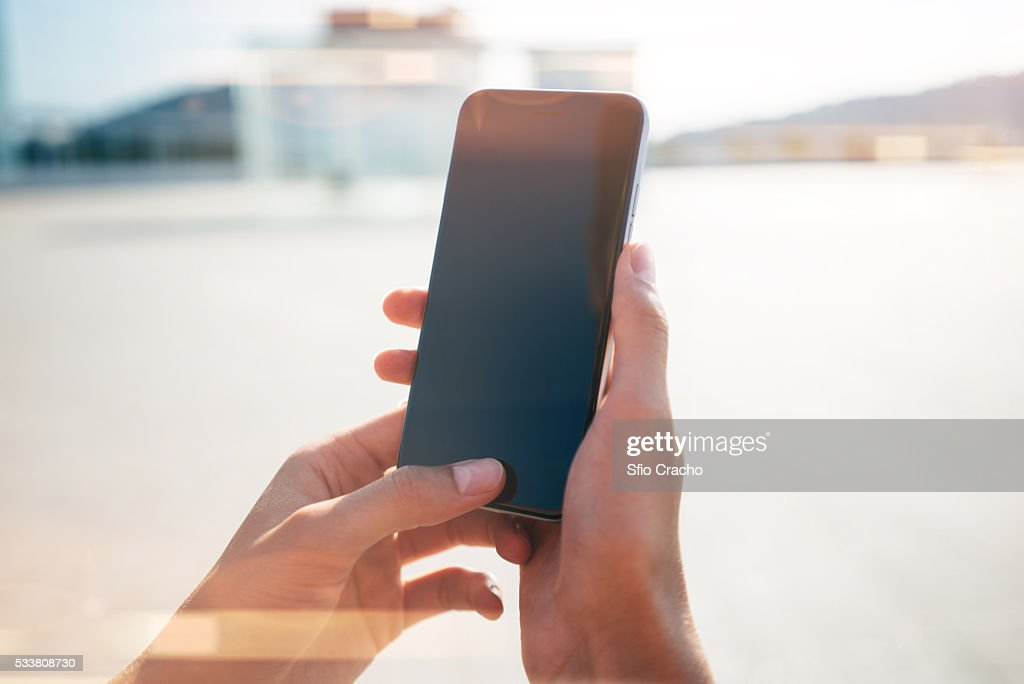 Close-up of a hand with smartphone : Foto stock