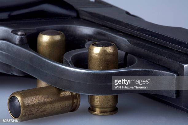 Close-up of a handgun with bullets