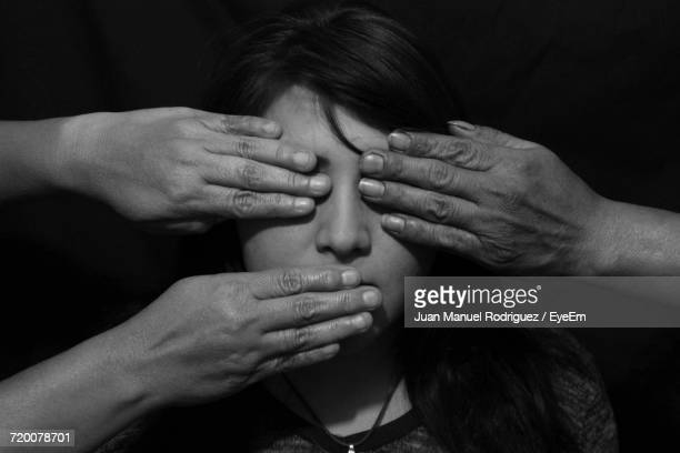 close-up of a hands on womans face - censura imagens e fotografias de stock
