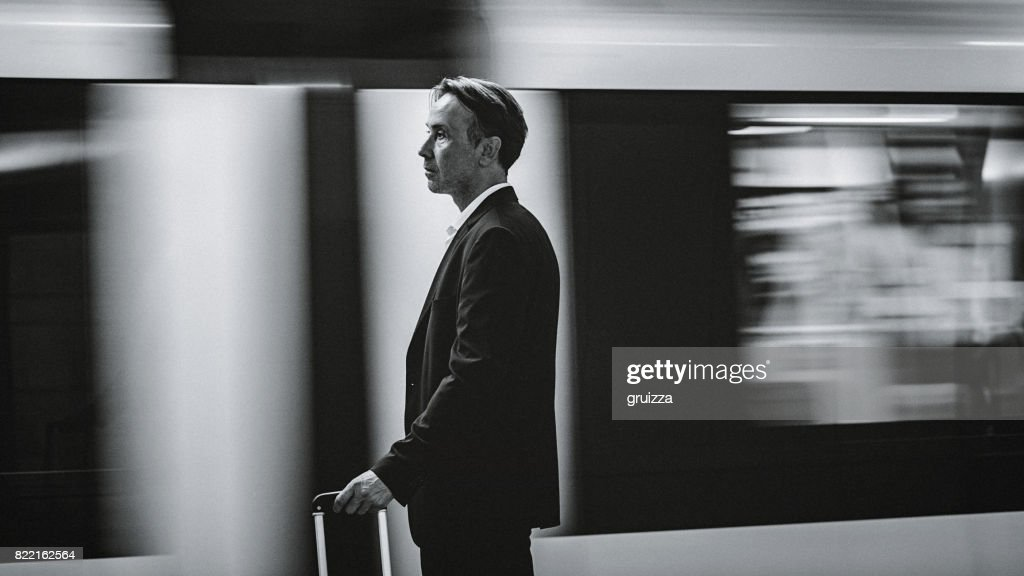 Close-up of a handsome, mature man on the metro station : Stock Photo