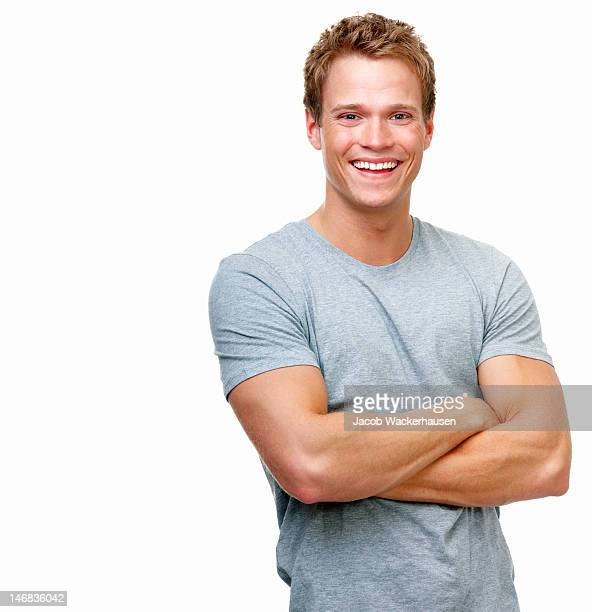 close-up of a handsome young man smiling against white background - human arm stockfoto's en -beelden