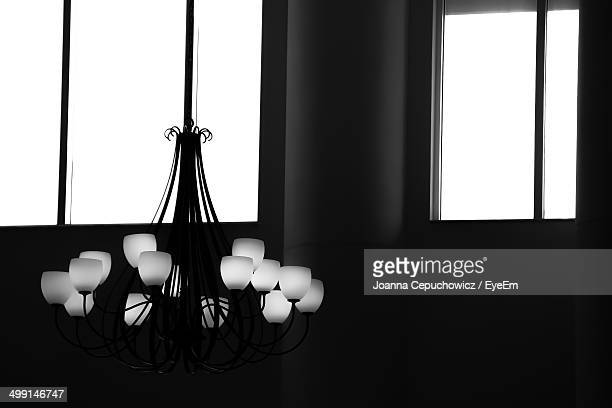 Close-up of a hanging light against window