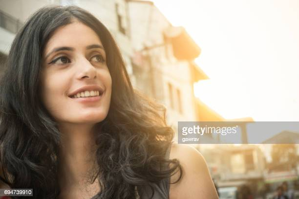 close-up of a happy asian girl on city street. - beautiful east indian women stock pictures, royalty-free photos & images
