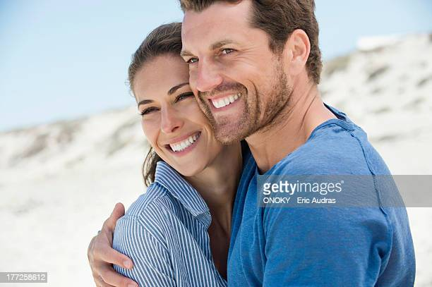 close-up of a happy couple on the beach - mid adult couple stock pictures, royalty-free photos & images
