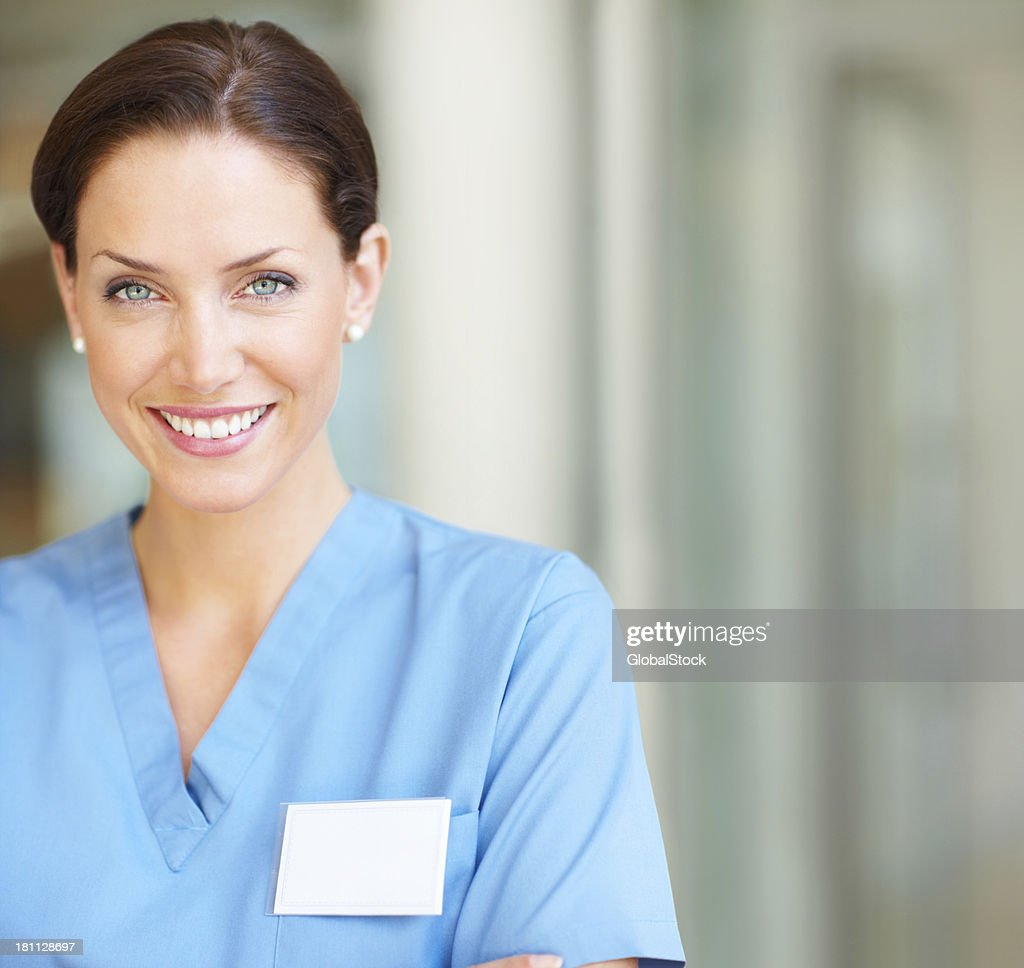 Close-up of a happy female nurse smiling : Stock Photo