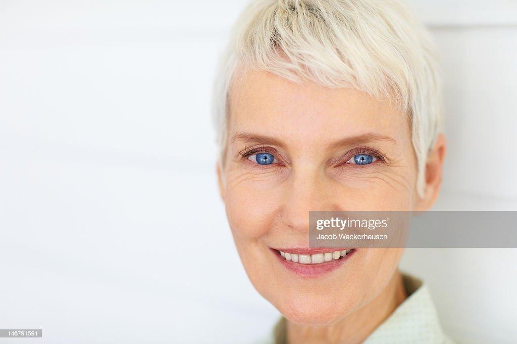 Close-up of a happy senior woman : Stock Photo