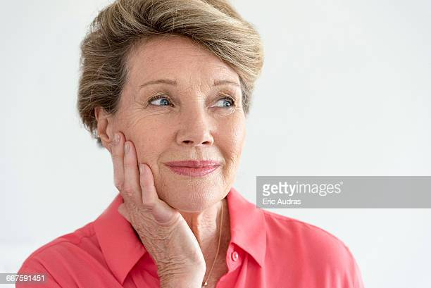 Close-up of a happy senior woman thinking