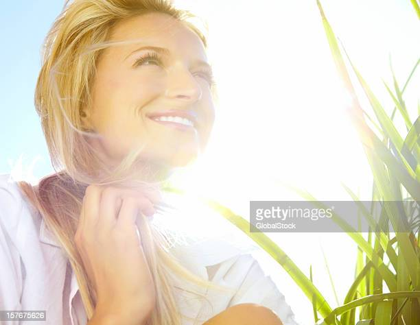 Closeup of a happy young woman enjoying summer