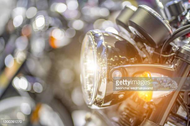 a closeup of a headlight on a motorcycle - リフレクター ストックフォトと画像