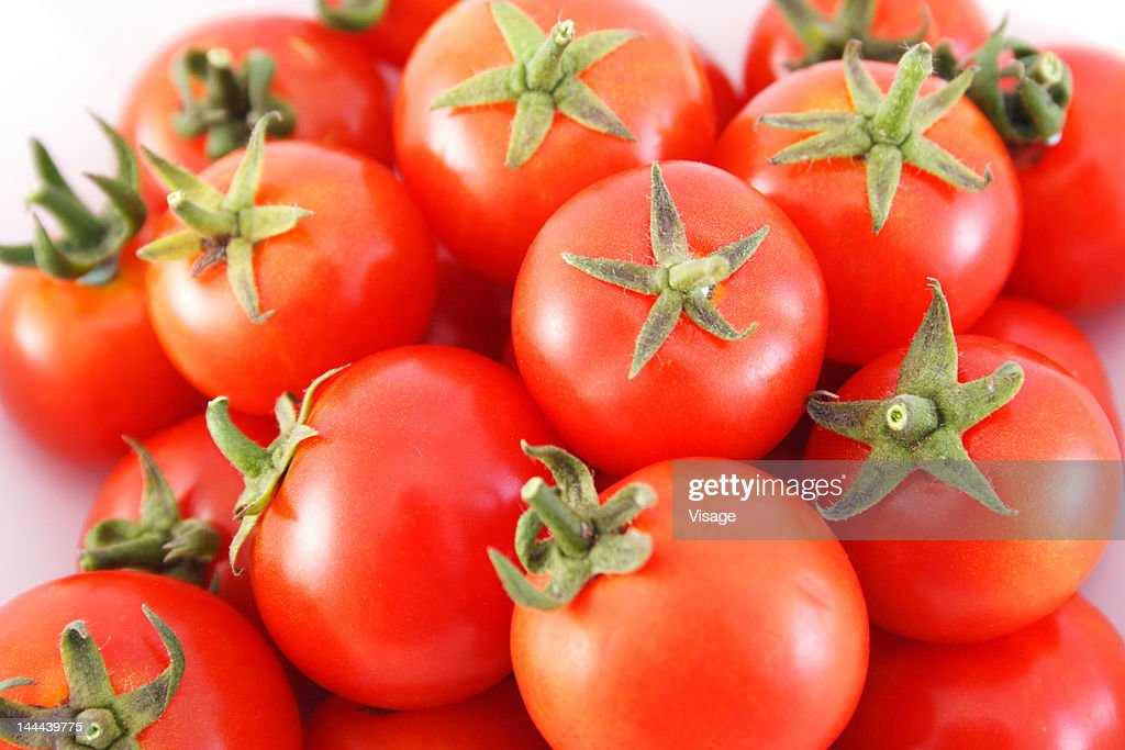 Close-up of a heap of tomatoes : Stock Photo