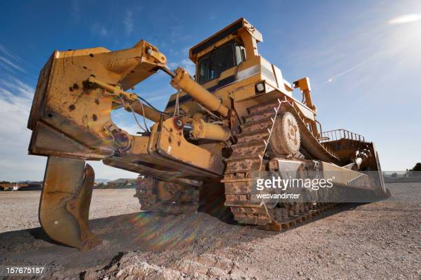 Close-up of a heavy equipment bulldozer covered in mud