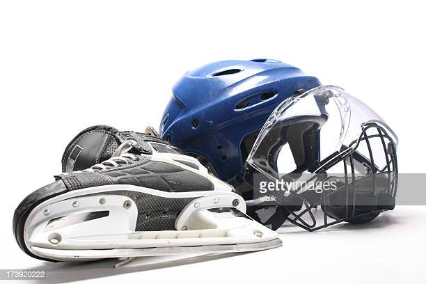 Close-up of a hockey helmet and skate