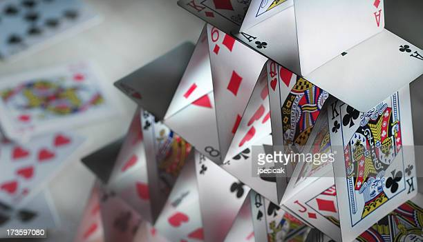 Close-up of a house of cards with spare cards in the back