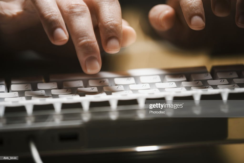 Close-up of a human finger typing on a computer keyboard : Stockfoto