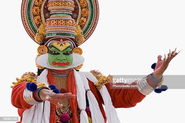 Close-up of a Kathakali dance performer dancing
