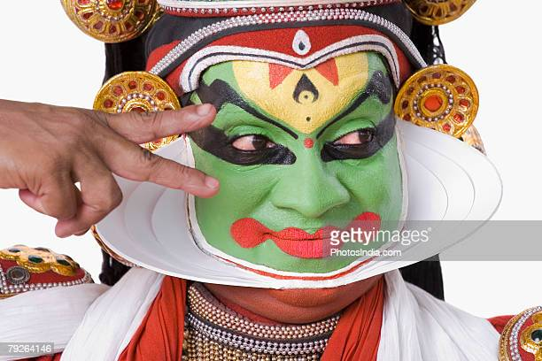 Close-up of a Kathakali dance performer gesturing