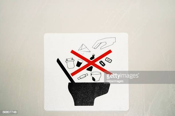 close-up of a lavatory disposal warning label - airplane bathroom stock pictures, royalty-free photos & images
