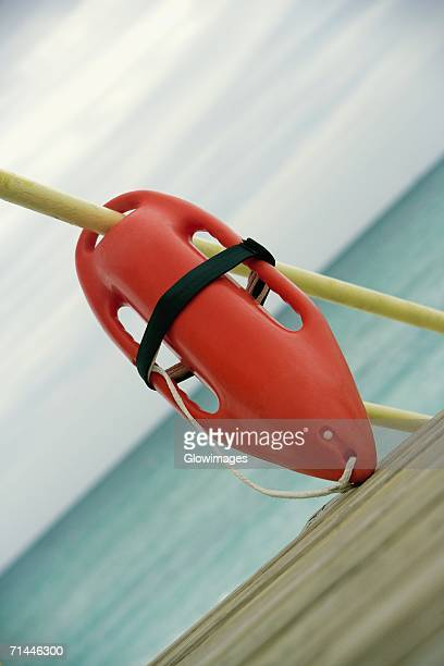 Close-up of a life jacket hanging on a pole