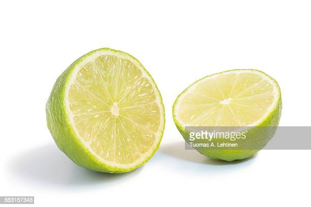 Closeup of a lime fruit cut in half isolated