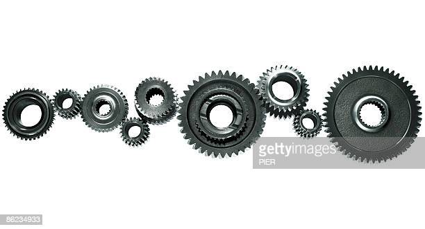 Close-up of a line of linked steel gears / cogs