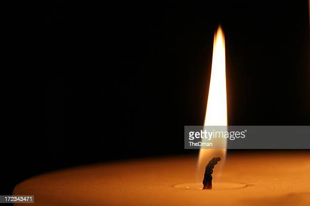 Close-up of a lit candle wick on a black background