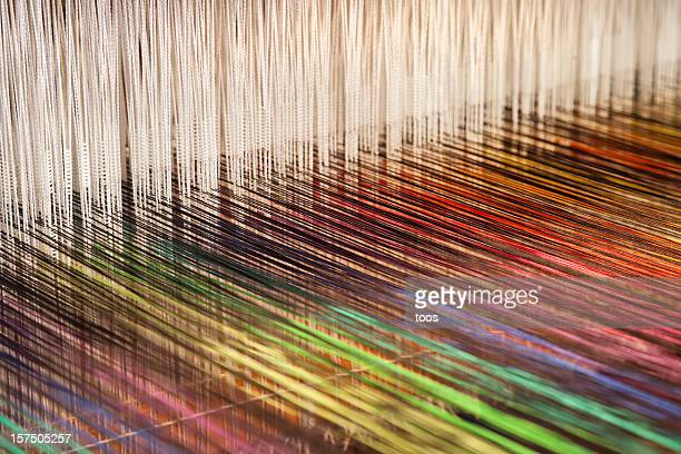 close-up of a loom weaving colorful fabric (xxxl) - woven stock photos and pictures