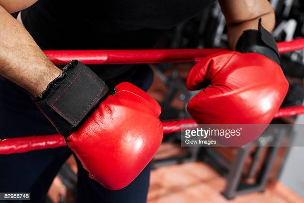 Close-up of a male boxer standing in a boxing ring