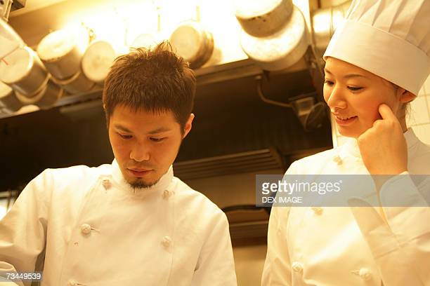 Close-up of a male chef and a female chef in the kitchen