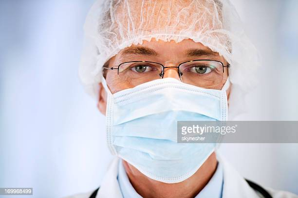close-up of a male doctor with surgical mask - flu mask stock photos and pictures