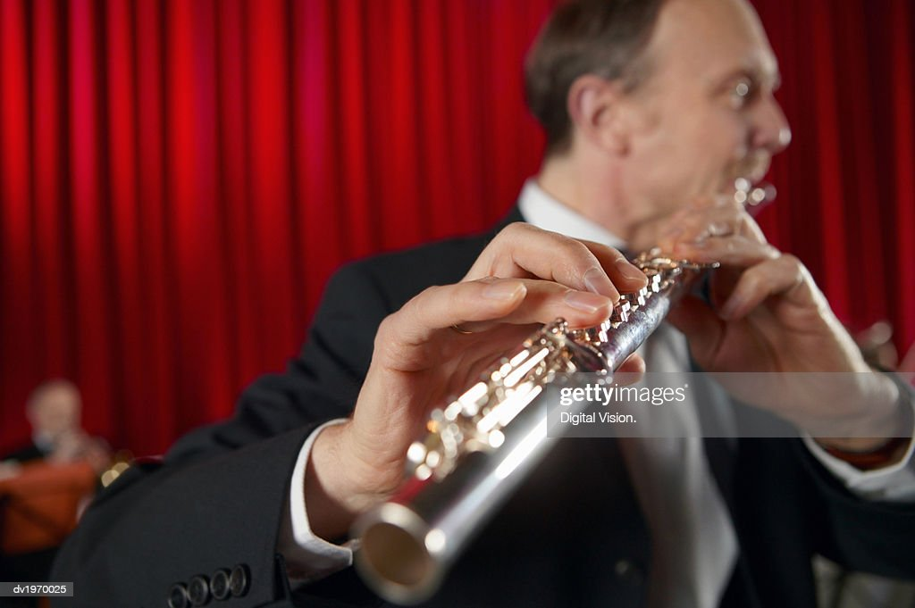 Close-Up of a Male Flautist Performing a Solo : Stock Photo