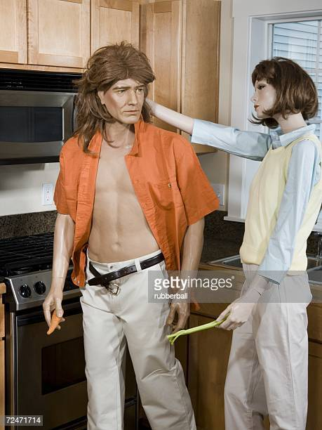 Close-up of a male mannequin and a female mannequin in the kitchen