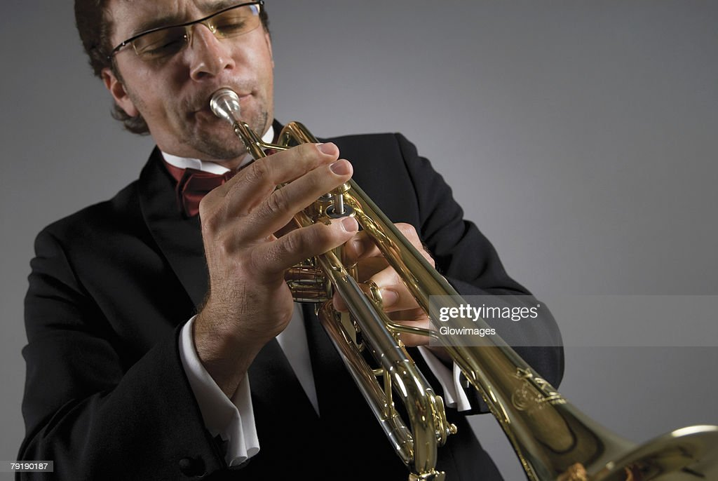 Close-up of a male musician playing a trumpet : Stock Photo