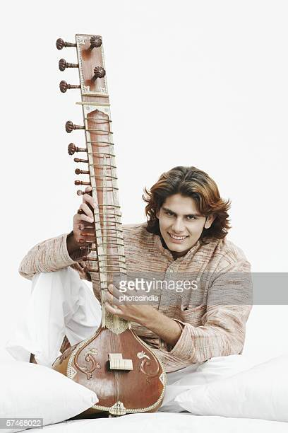 Close-up of a male musician playing the sitar