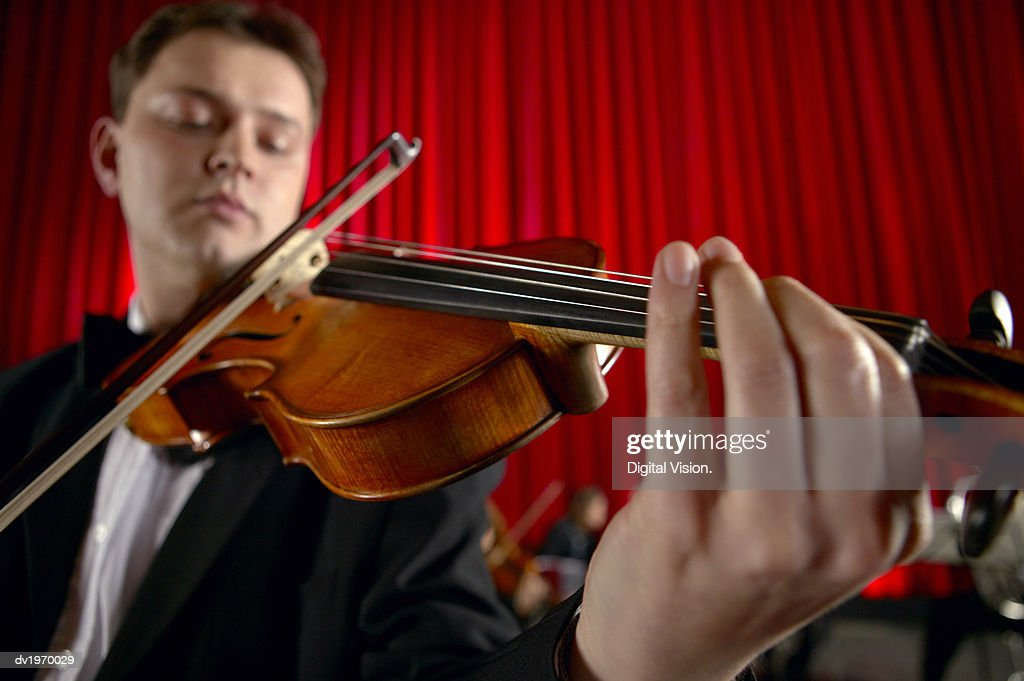 Close-Up of a Male Violinist Performing : Stock Photo