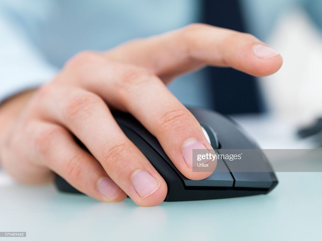 Closeup of a male's hand working on a computer mouse : Stock Photo