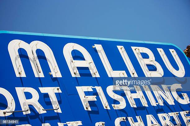 close-up of a malibu fishing charters sign, malibu, california, usa - malibu stock pictures, royalty-free photos & images