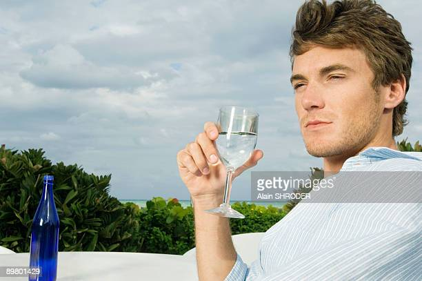 Close-up of a man drinking water