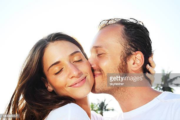 Close-up of a man kissing his girlfriend