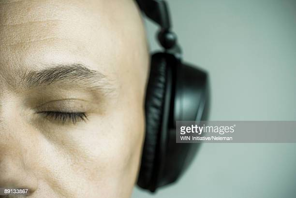 Close-up of a man listening to headphones