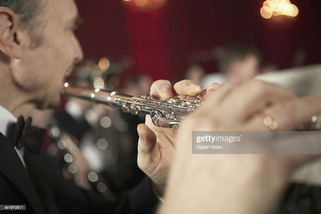 Close-Up of a Man Playing a Flute : Stock Photo