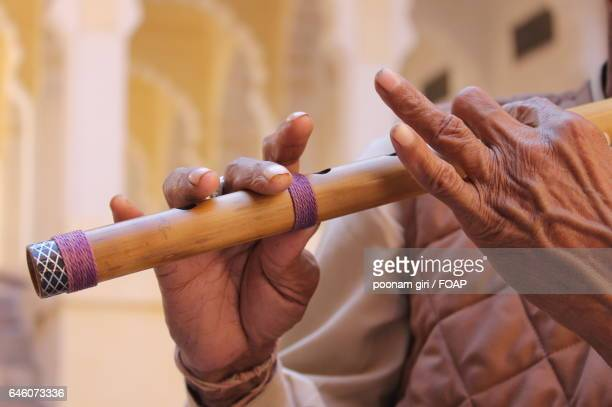 Close-up of a man playing flute