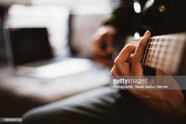 close-up of a man playing guitar - african american culture stock pictures, royalty-free photos & images