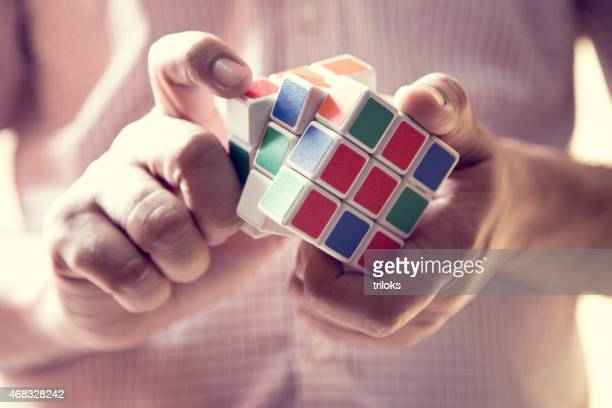Close-up of a man playing puzzle cube