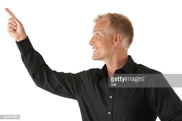Close-up of a man pointing upward