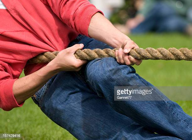 Close-up of a man pulling on a rope in tug of war