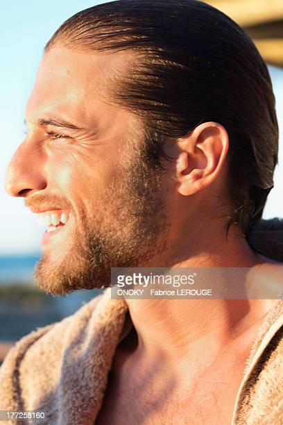 close-up of a man smiling - onoky stock-fotos und bilder